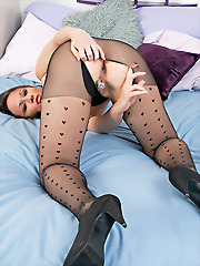Lucy rips her black pantyhose..