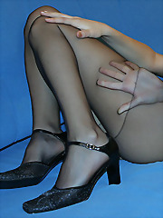 Black pantyhose ripped to show..